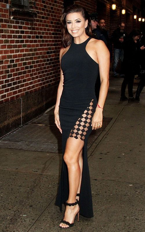 Eva Longoria porte une robe longue fendue