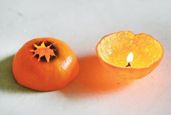 Une bougie fabriquée avec une clémentine.
